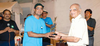Man of the series  shri rishab shah accepting the trophy